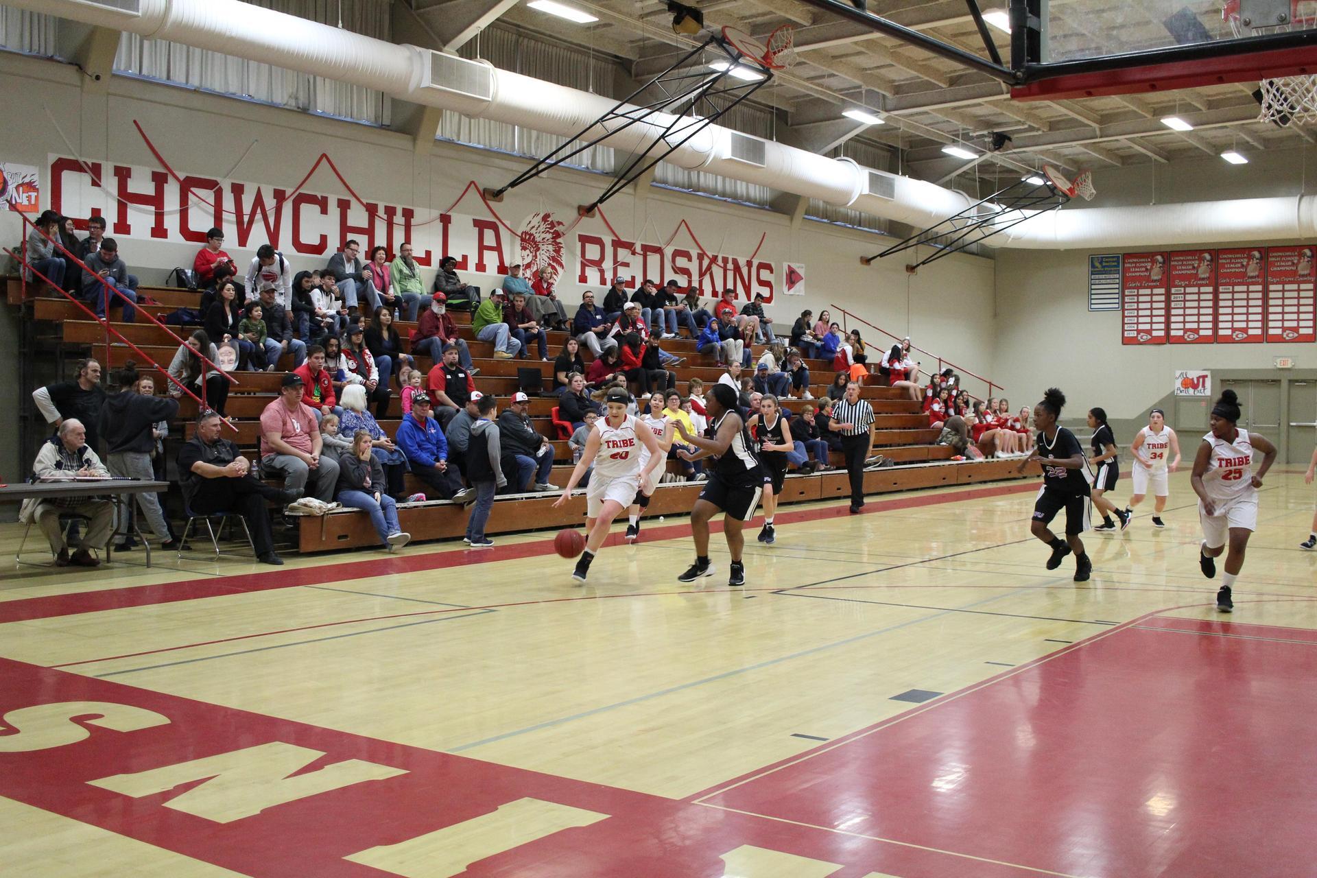 JV Girls playing basketball against Washington Union