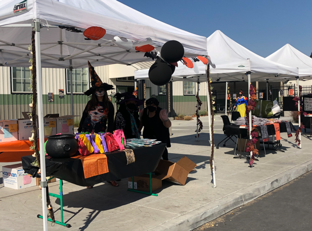 booths set up in Santee school parking lot for trick or treat event
