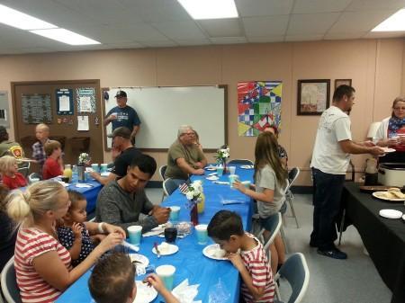 Veterans and family enjoying breakfast in their honor