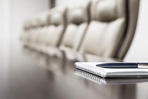 A vacant Board Room dias. Shutterstock.com