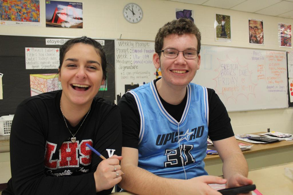 Two students smiling