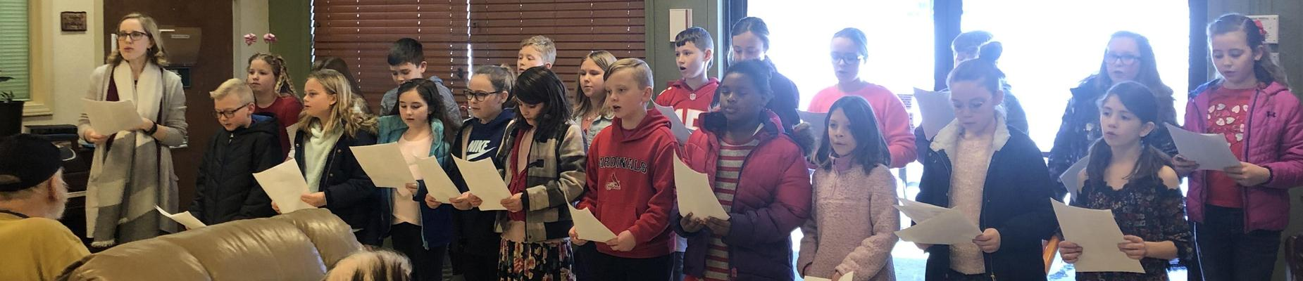 Group of kids singing at nursing home