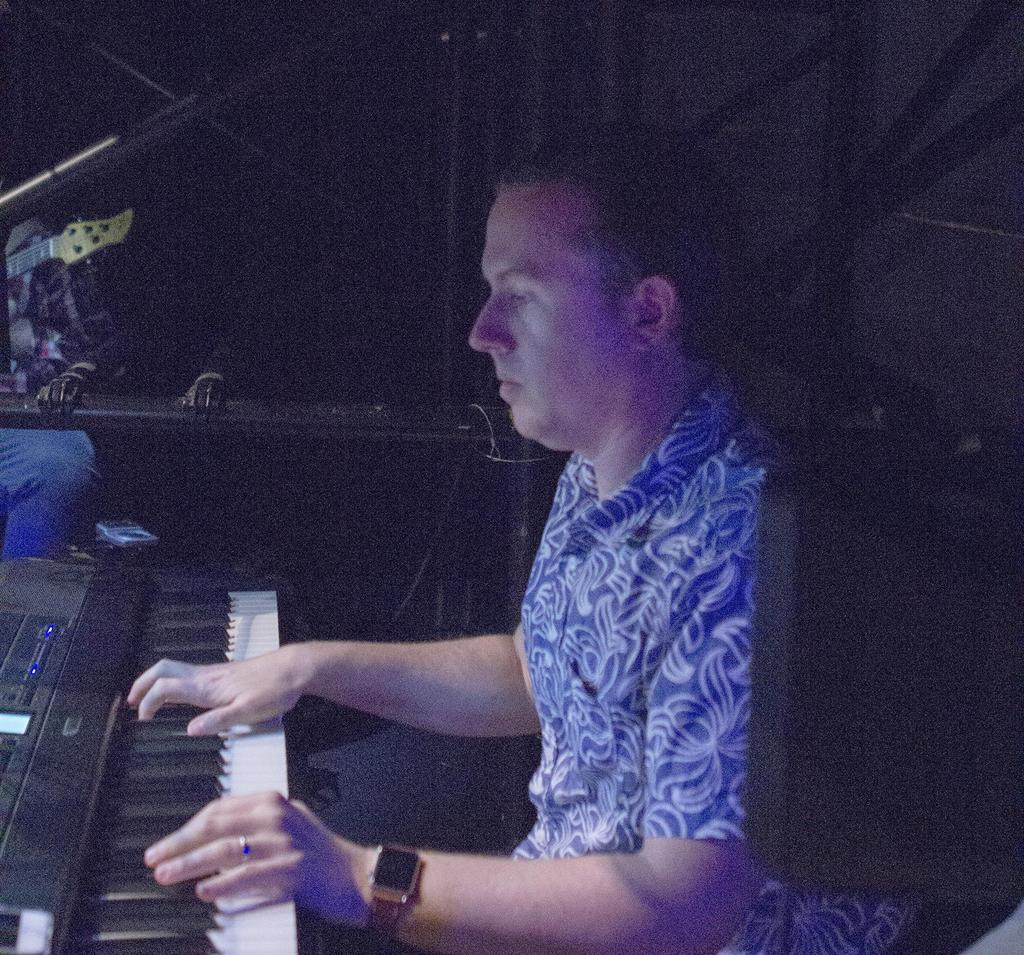 Keyboardist Steve Black plays during the production