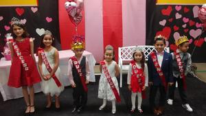 The Royal Court poses for a picture at the Valentine's Dance.