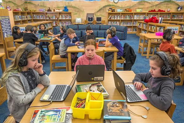 Students on chromebooks in the media center