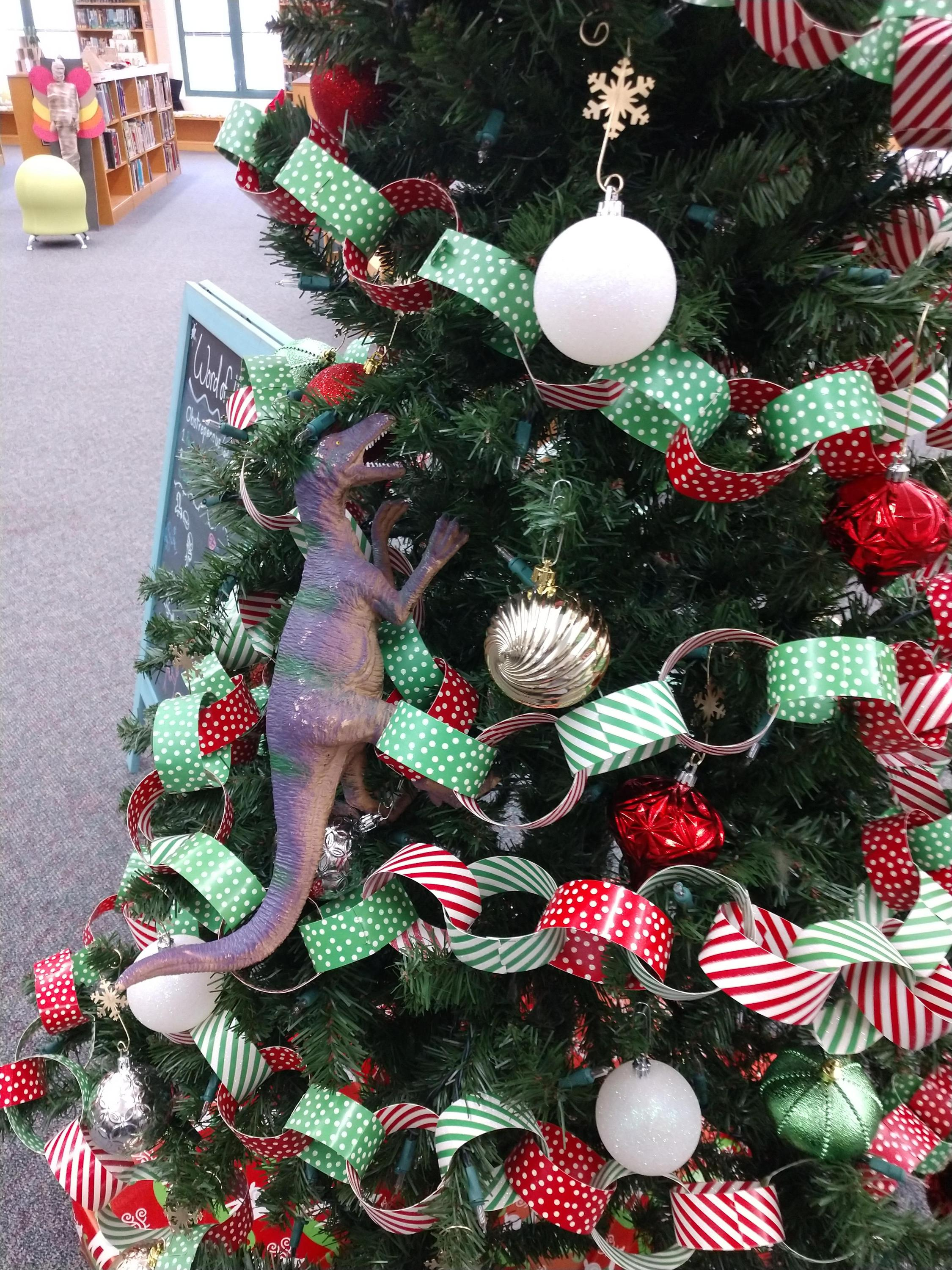 Steve the dinosaur wrecking the library christmas tree!