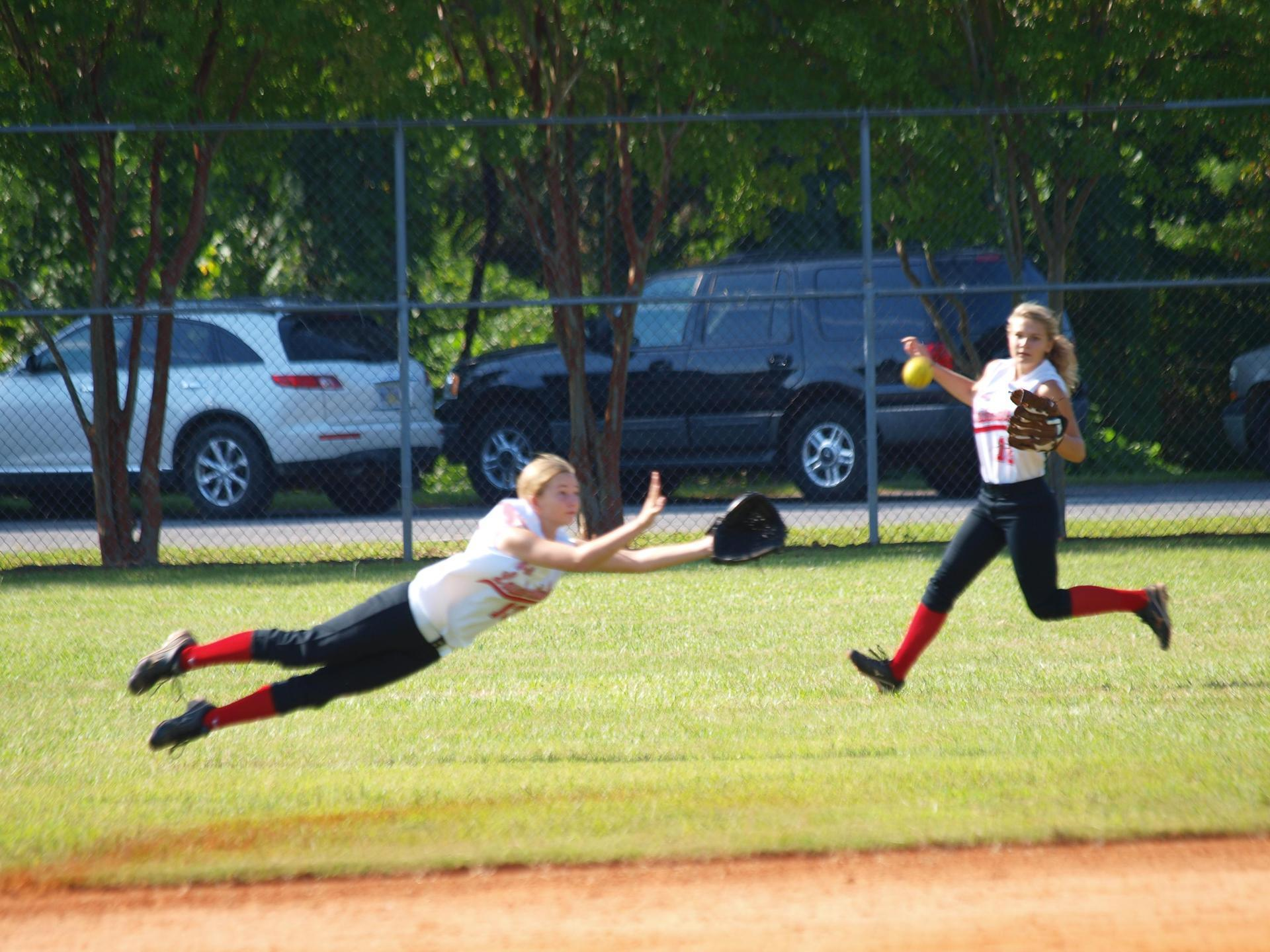 WLHS Fast-Pitch Softball Players in action