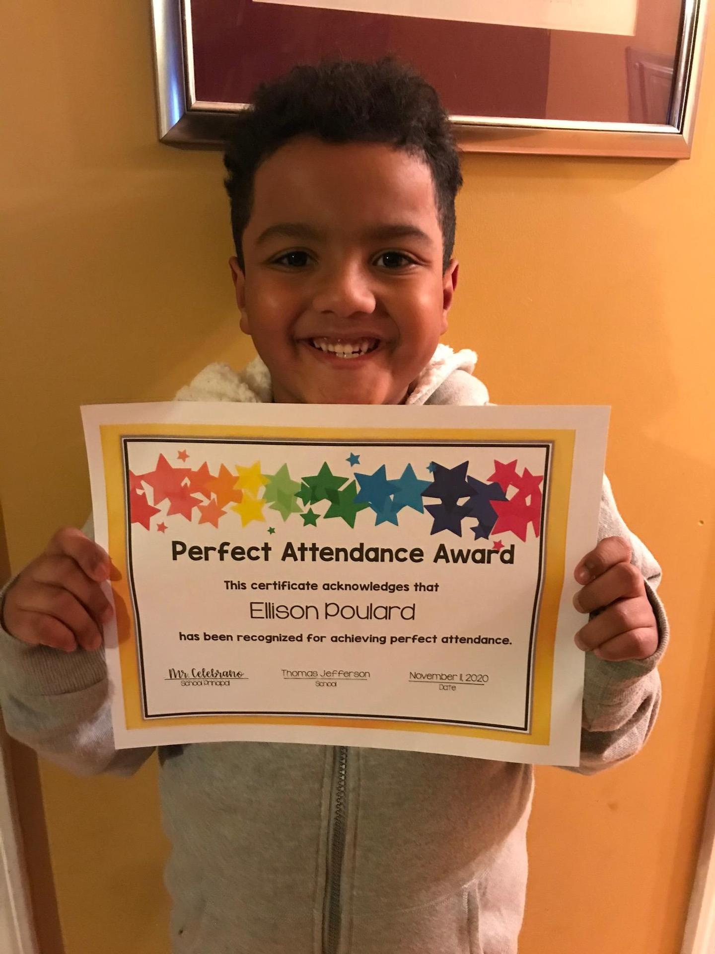 Ellison Poulard holding perfect attendance certificate