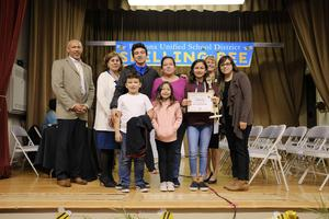 First place winner with her family, the spell master (Delbert Duckins), Lilia Fuentes, her teacher (Claudia Vasquez), and me.