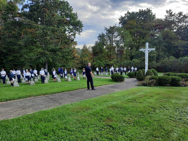 image of OLSH students praying the rosary at the Sisters' Cemetery