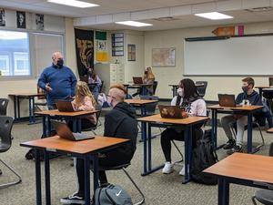 Mr. Brown talks to his students in class.