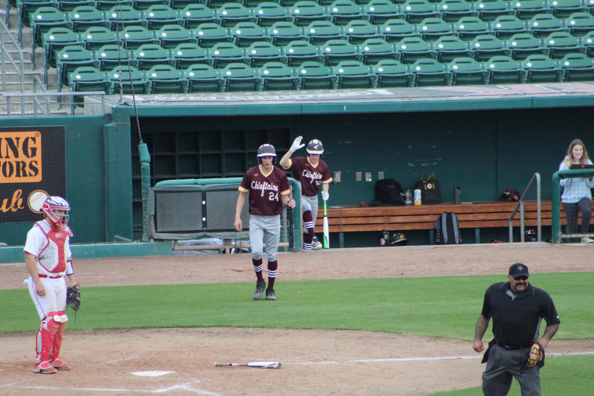 varsity baseball players in action against sierra at chukchansi park