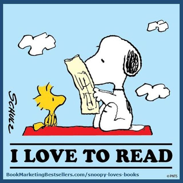 Snoopy reading a book