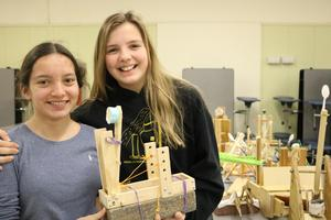 Photo of Edison Intermediate School 8th graders Anna Bongiovanni (left) and Katherine Gibbemeyer team up to design and build a catapult during a semester-long Science Olympiad that culminated in an inter-school competition with Roosevelt Intermediate School.