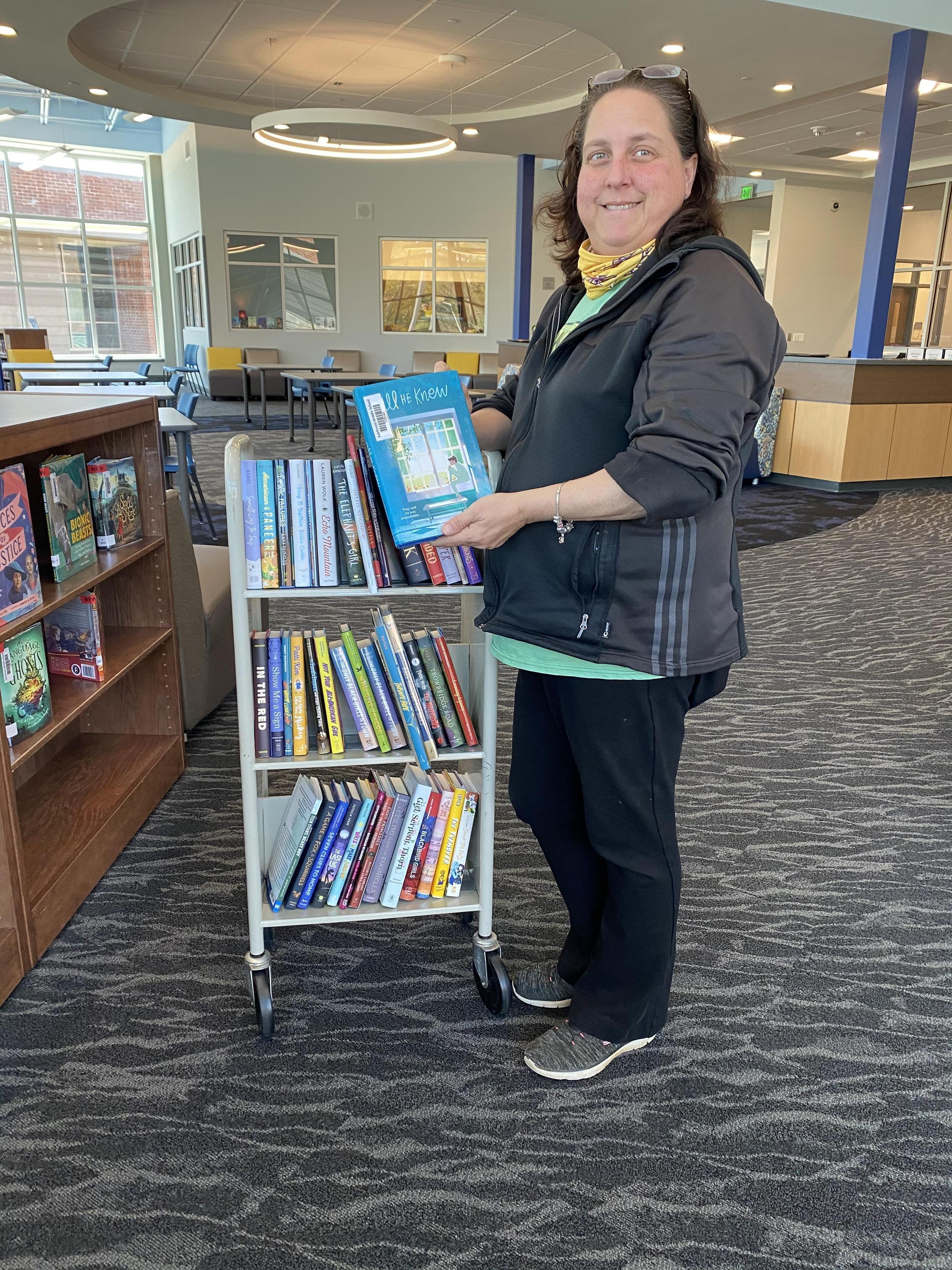 Ms. Biggerstaff shelving books