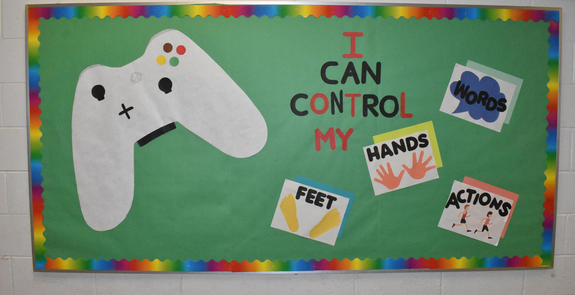 A bulletin board with a game controller and the words,