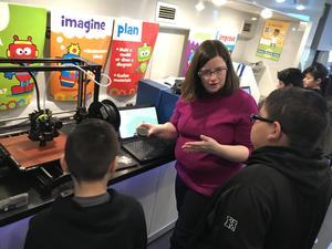 Students learning about the 3-d printer