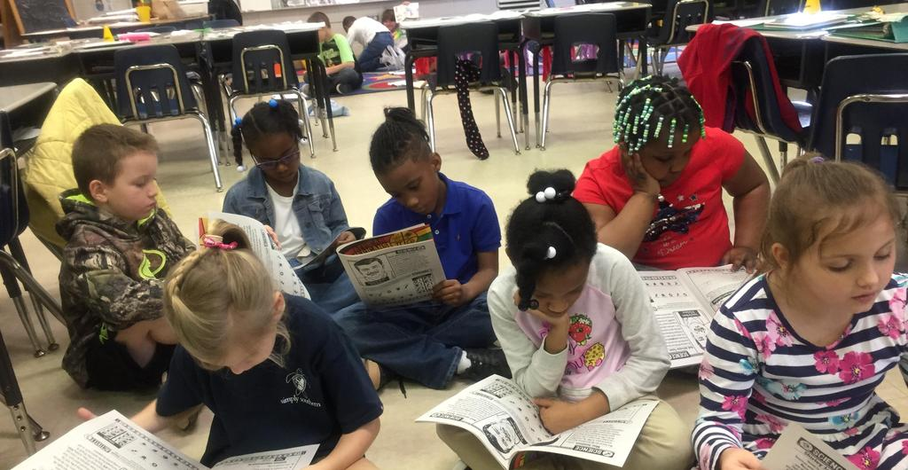 Second graders reading together