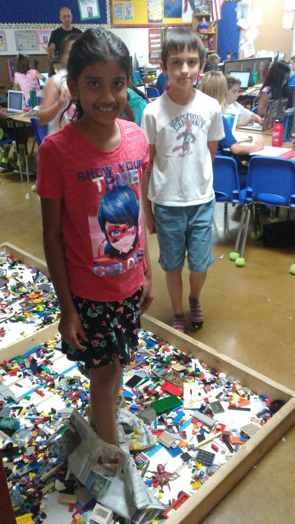 Fifth graders engineer newspaper shoes to protect their feet on a bed of legos.2