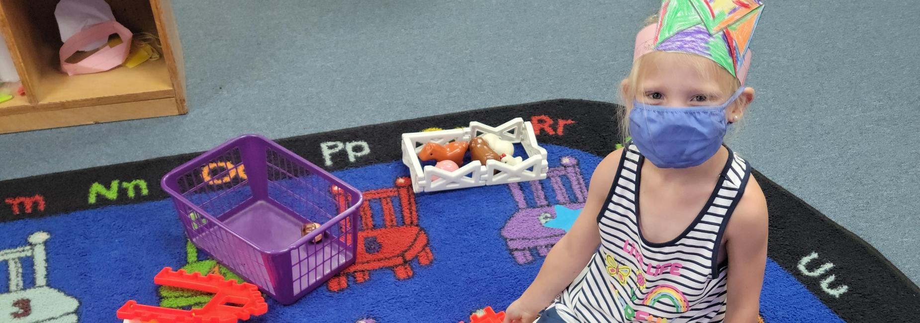 Kindergarten student using building squares.