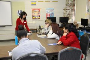 Denise Dunovant, a Student Services Program Coordinator from Midlands Technical College, speaks with students at the Lifelong Learning Center as part of its Workplace Wednesdays program.