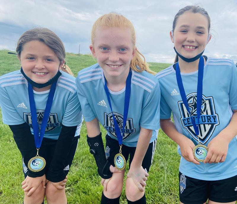 pic of 3 soccer players with their medals