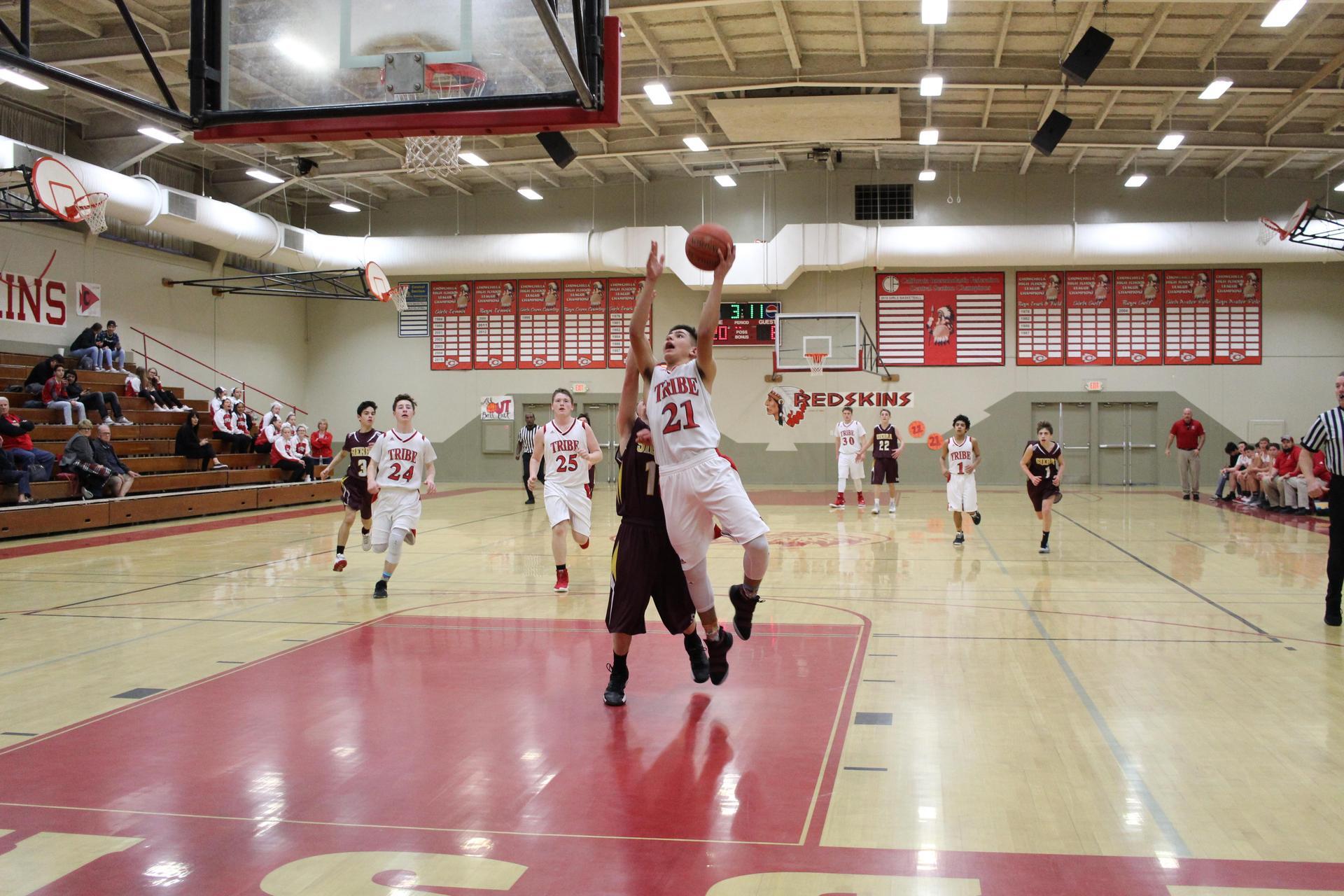 JV Boys playing basketball vs Sierra