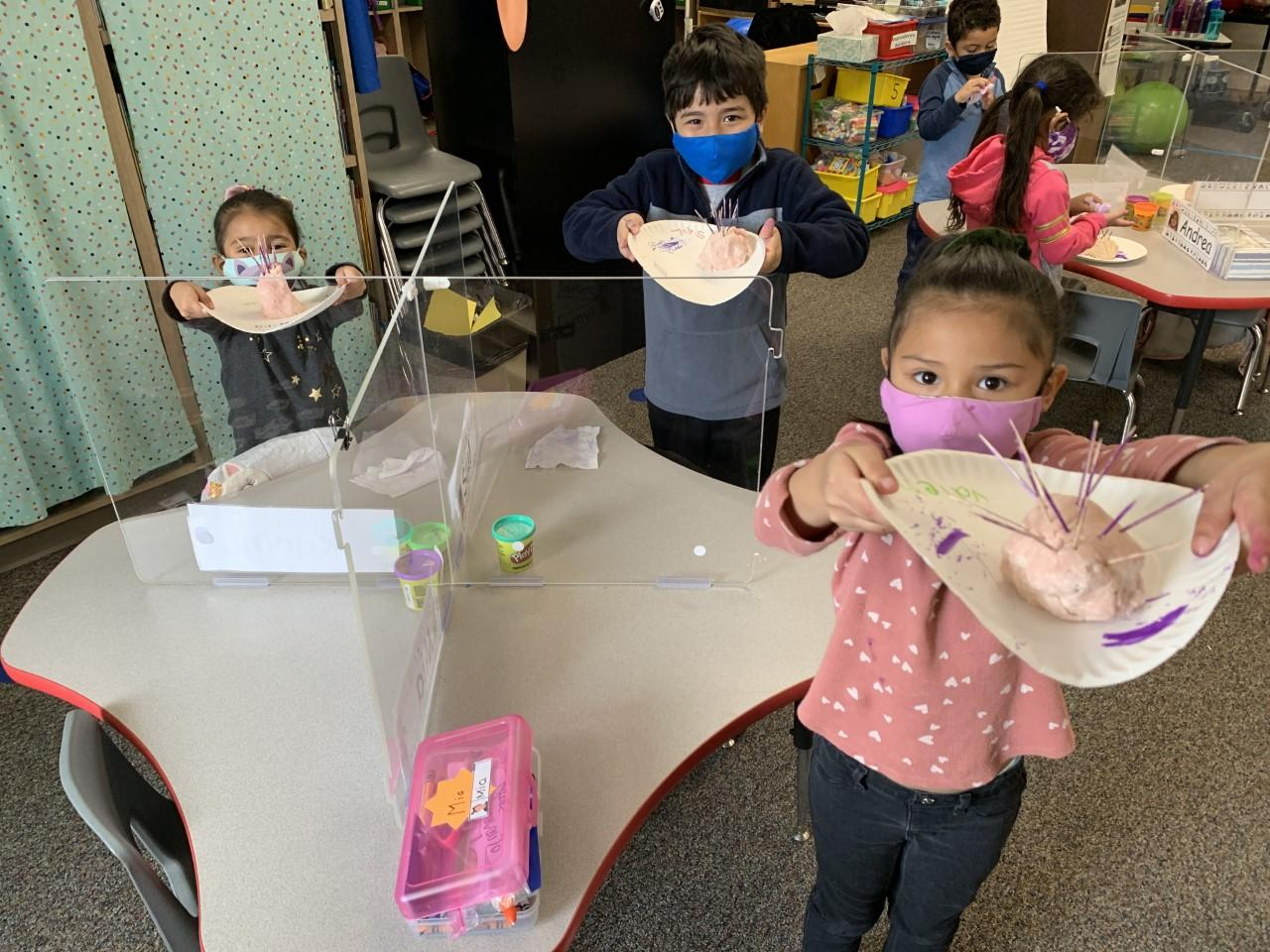 West Elementary pre-kindergarten students made sea urchins out of homemade Play Dough. The kids are learning about ocean animals and the color purple. Their teacher is Claudia Myers.