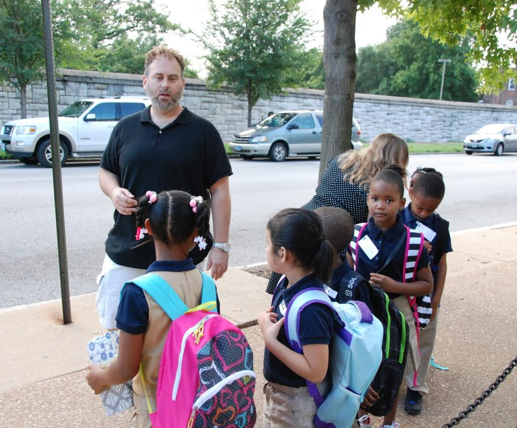 Students with backpacks, teachers 2016-17