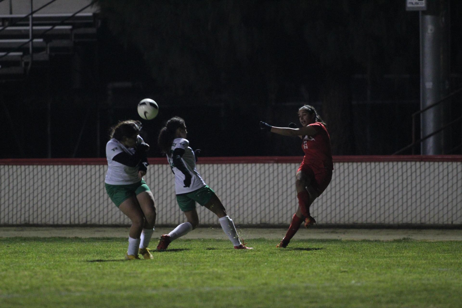 Girls playing soccer against Roosevelt