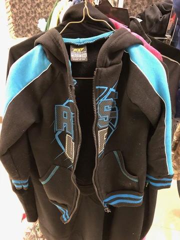 black jacket with teal sleeves