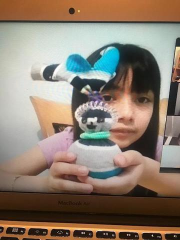 girl holding sock bunny