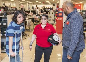 Student at JCPenney shopping with employees
