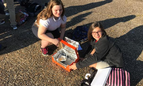 Baking s'mores in the solar ovens