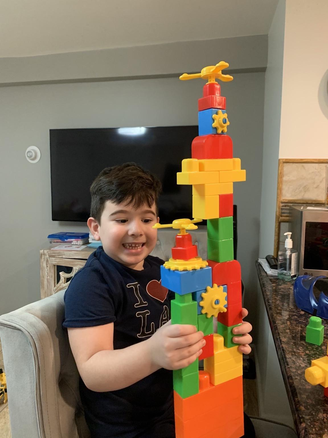 boy with lego structure