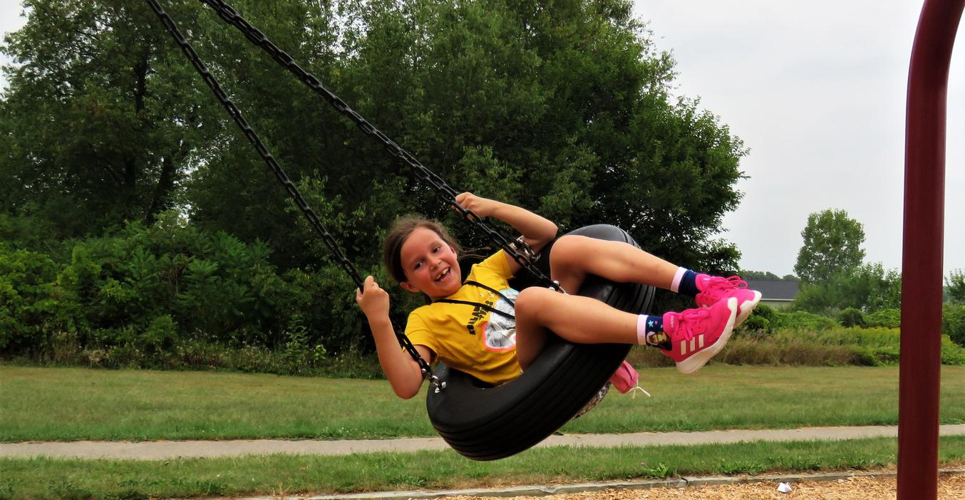 The tire swing is a favorite part of the Lee playground.