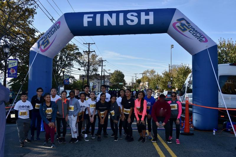 Fitness Club group photo at finish line