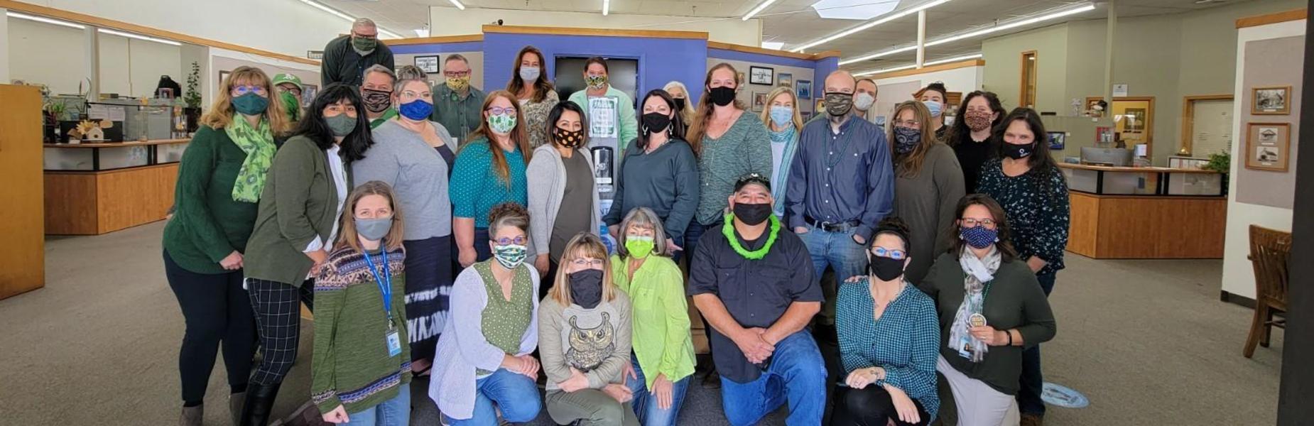 CCOE employees wear green