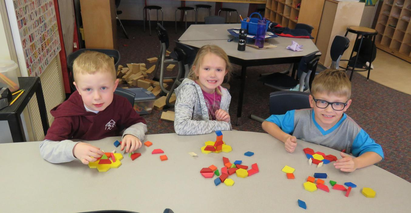 Kindergarten students learn about shapes with Math blocks.