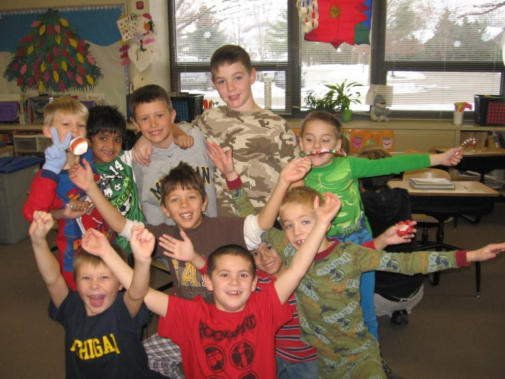 boys pose in class with their arms up