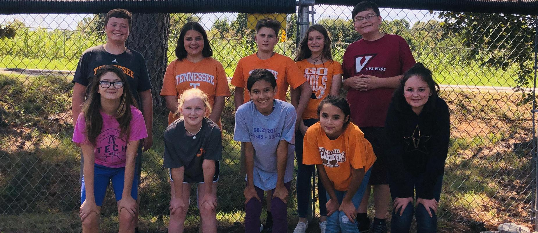 6th - 8th grade students wearing college colors