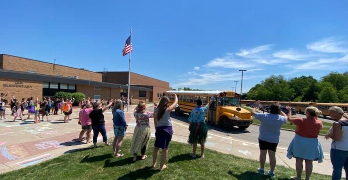 Lee staff wave goodbye on the last day of school.