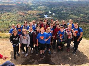 students atop mountain
