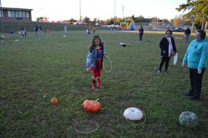 A student plays a game at the fall festival.