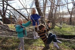 Preschool students exploring a ropes course.