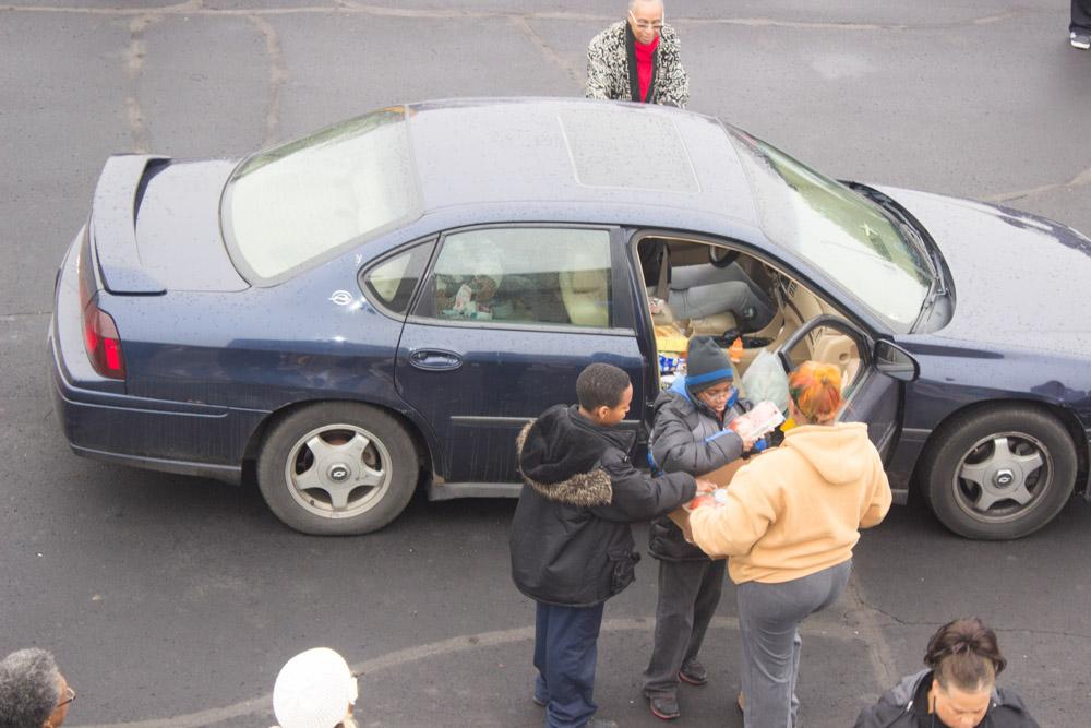 people loading cars