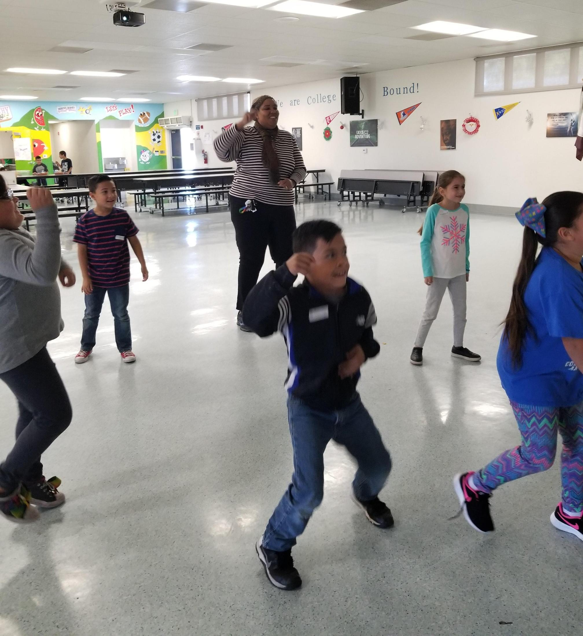 Sheila Watkins showing off her Fortnite dance moves with Hyatt Elementary students