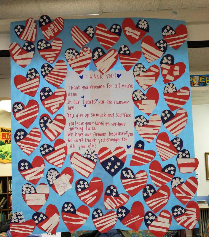 A heartfelt poem in the McKinley School library greets veterans as they arrive for a special commemoration on Veterans Day on Nov. 12.