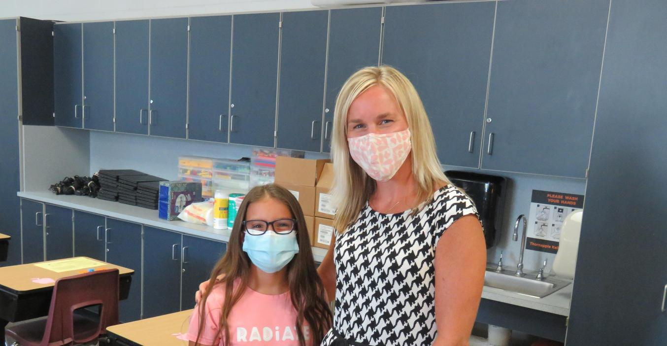 A Page Elementary teacher greets a student during open house.