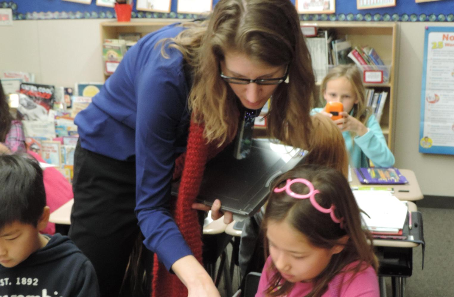 Mrs. Sabio working with a student